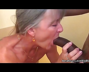 Grey haired granny enjoys large dark pecker