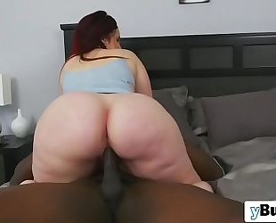 Chubby redhead floozy engulfing and riding giant dark penis