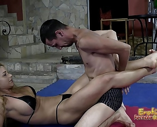 Victorious wrestling dominatrix-bitch jerks off her loser thrall