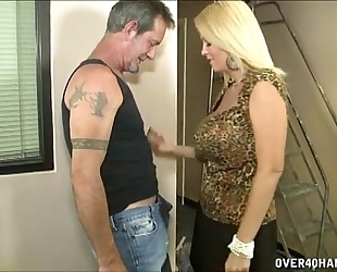 Hot breasty milf jerks off a aged stud