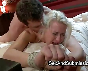 Tied blond copulates in ottoman from behind by inflexible dick