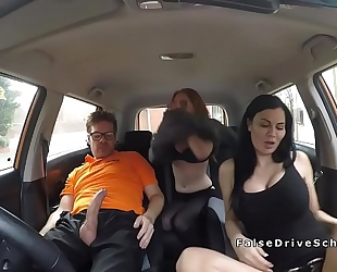 Redhead in trio in fake driving school