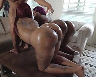Two chubby ebonies with huge asses get oiled up and fucked in threesome