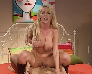 Blonde MILF rides big man sausage with passion and lust