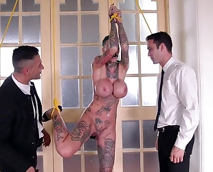 Short-haired skank with huge fake tits gets double fucked