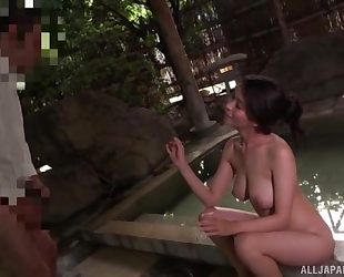 Stunning Asian babe sucks lover's pecker by the pool