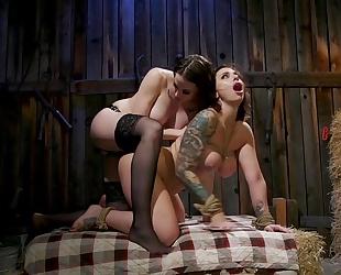 Lesbian mistress in stockings fucks her tattooed slave