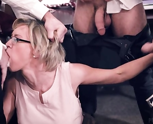 Four horny students fucks their busty teacher in the classroom