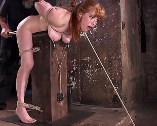 Redhead minx gets tied up and tortured in the dungeon