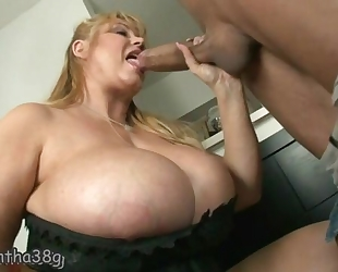 Fat mature with incredibly huge tits gets fucked well