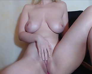 Naked camgirl plays with her soaking wet pussy