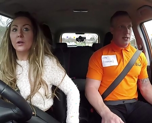 Long-haired MILF blows her car driving instructor