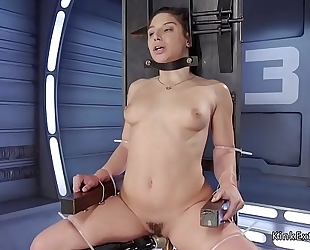 Brunette in thraldom fucking machine