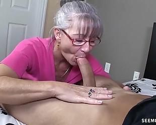 Horny granny sucks a young pecker